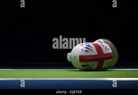 Rio de Janeiro, Brazil. 12th August, 2016. GBR fencing mask lays on the mat. Union flag face. Russia v TeamGB. Mens - Stock Photo