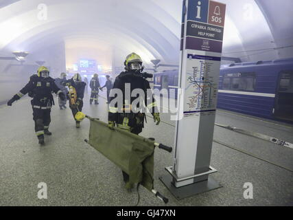 St Petersburg, Russia. 12th Aug, 2016. Emergency workers pictured during an emergency response exercise at Sportivnaya - Stock Photo