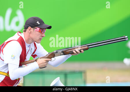 Rio de Janeiro, Brazil. 12th Aug, 2016. Sebastian Kuntschik of Austria competes in the Skeet Men's Qualification - Stock Photo