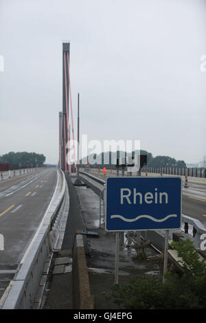 Cologne, Germany. 12th Aug, 2016. A sign reading 'Rhein' can be seen on the Leverkusener bridge of the motorway - Stock Photo