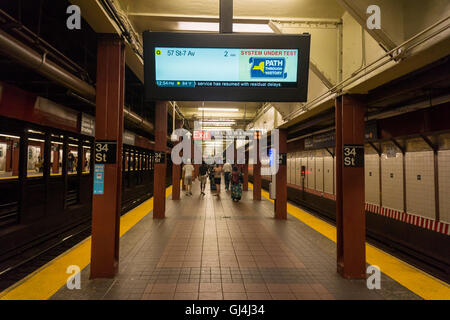 A test of the new digital countdown clocks to be installed on the lettered lines in the New York subway is seen - Stock Photo