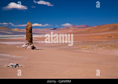 geological monolith close to Salar Aguas Calientes, desert Atacama, Chile - Stock Photo