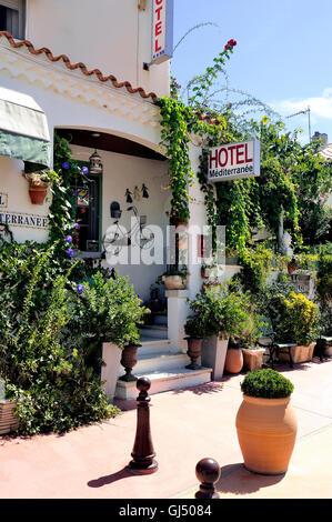 facade of a nice little hotel in Saintes-Maries-de-la-Mer in the city center. - Stock Photo