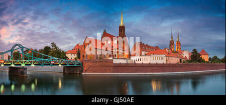 Panoramic image of Wroclaw, Poland during twilight. This is composite of two horizontal images stitched together - Stock Photo