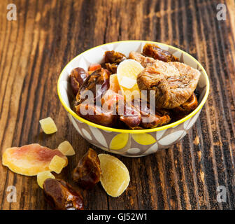 Dried and candied fruits assortment in a bowl - Stock Photo