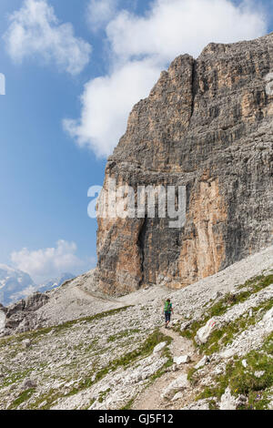 Traveller (female) in the stony Sella-ring bath, climbing to the Piz Boé, Dolomites, South Tyrol, Italy, Europe, - Stock Photo