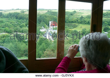 The Great Laxey Wheel (Lady Isabella), as seen from the Snaefell Mountain Railway. Laxey, Isle of Man, British Isles. - Stock Photo