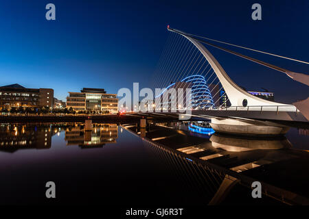 The Samuel Beckett Bridge over the river Liffey, Dublin at night - Stock Photo
