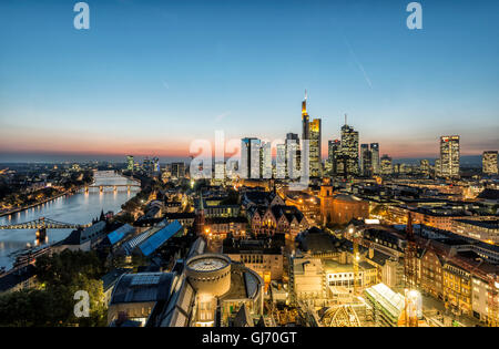 Frankfurt am Main, Hesse, Germany, skyline of Frankfurt with the city centre and the financial district, dusk - Stock Photo