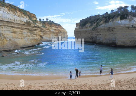 People sightsee Loch Ard Gorge  in Victoria Australia. - Stock Photo