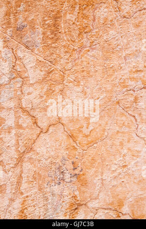 Close up of the texture of an ancient cracked terracotta wall - Stock Photo