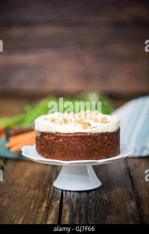 homemade fresh carrot cake with icing decorations - Stock Photo