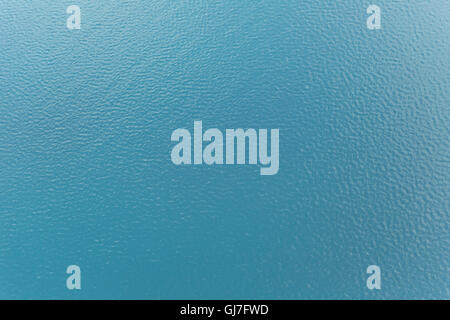 Sea surface background with waves and reflection of sunlight from above - Stock Photo