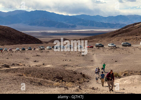 Tourists hiking on volcanic and sedimentary hills near Artist's Palette in Death Valley National Park, California, - Stock Photo