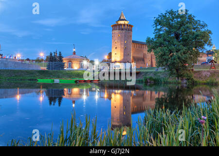 Tower an wall of Kolomna kremlin reflecting in water in the evening, Kolomna, Moscow region, Russia - Stock Photo