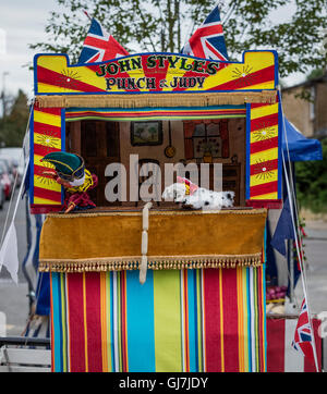 ... Spotted dog with sausages and Mr Punch at a Punch and Judy puppet booth - Stock & Spotted dog with sausages and Mr Punch at a Punch and Judy booth ...