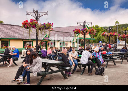 People sitting outside the Station Buffet at Llanberis Station, Snowdonia National Park, Gwynedd, Wales, UK - Stock Photo