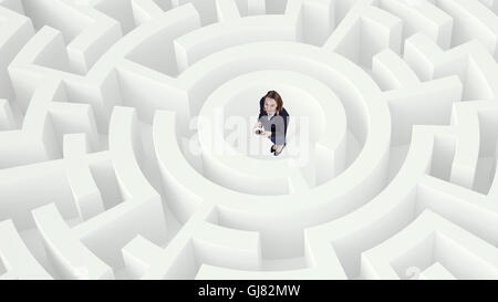 Businesswoman in labyrinth center Mixed media . Mixed media - Stock Photo