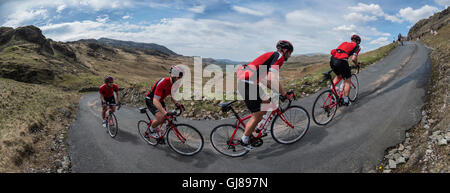 Rider in the Fred Whitton Challenge cycling Hardknott Pass, Cumbria, UK. - Stock Photo