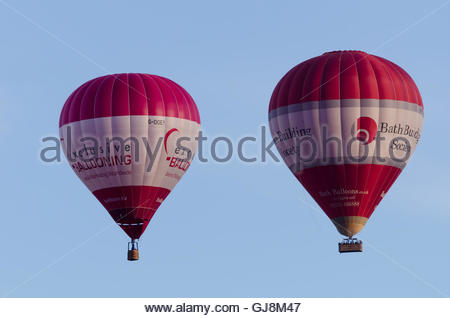 Bristol, UK. 13th August 2016. Balloons taking part in Bristol's International Balloon Fiesta flies over Bristol - Stock Photo