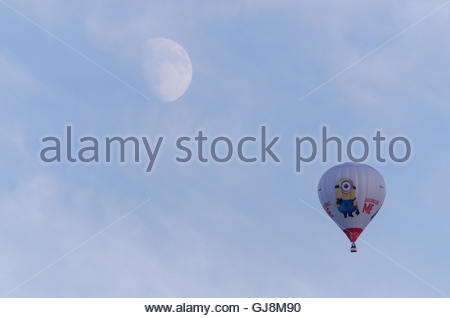 Bristol, UK. 13th August 2016. A balloon taking part in Bristol's International Balloon Fiesta flies over Bristol - Stock Photo