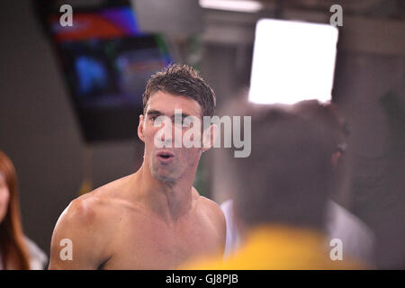 Rio de Janeiro, Brazil. 13th Aug, 2016. Michael Phelps of the USA reacts after the Men's 4 x 100m Medley Relay Final - Stock Photo