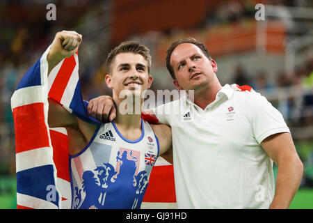 Rio De Janeiro, Brazil. 14th Aug, 2016. Max Whitlock of Great Britain (L) celebrates with his coach after the men's - Stock Photo