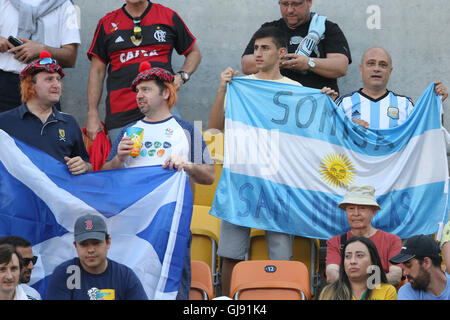 Rio de Janeiro, Brazil. 14th Aug, 2016. The Scottish Saltire flag and the Argentinian flag being waved side by side - Stock Photo