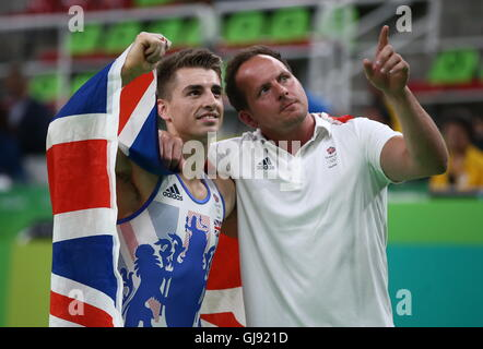Rio De Janeiro, Brazil. 14th Aug, 2016. Artistic gymnast Max Whitlock (L) of the United Kingdom with coach Scott - Stock Photo