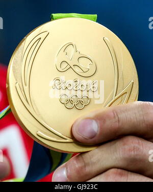 Rio De Janeiro, Brazil. 14th Aug, 2016. A gold medal of the Rio 2016 Summer Olympic Games. Credit:  Valery Sharifulin/TASS/Alamy - Stock Photo