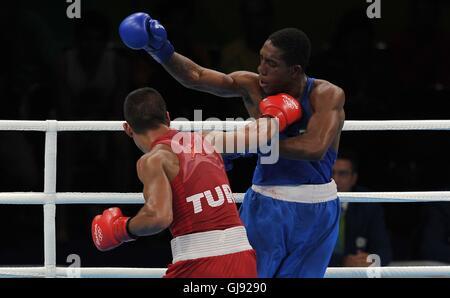 Batuhan Gozgec (TUR, red) and Joedison Teixeira (BRA). Boxing. Riocentro 6. Olympic park. Rio de Janeiro. Brazil. - Stock Photo