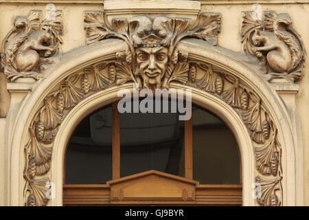 Art Nouveau mascaron on the revenue house in Dukelských Hrdinů Street in Holešovice district in Prague, Czech Republic. - Stock Photo