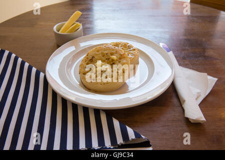 Buttered Crumpets - Stock Photo
