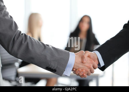 Close-up of handshake of businessmen on meeting in office - Stock Photo