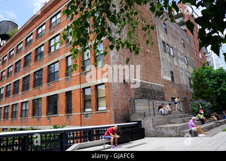 Tourists relaxing at the New York City High Line in the Chelsea area of Manhattan NYC, NY, USA - Stock Photo