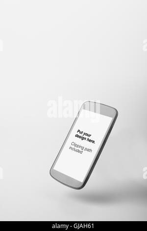 Modern smart phone with blank screen isolated on white. Include clipping path for phone - Stock Photo