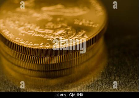 gold bullions American eagle - Stock Photo