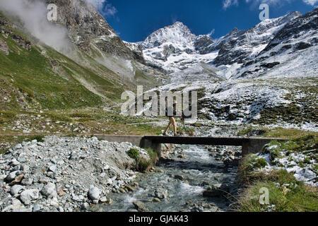 Crossing under the Ober Gabelhorn along the trail to the Schonbielhutte, Zermatt, Switzerland - Stock Photo