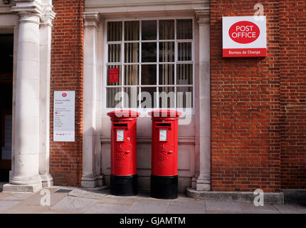 Chichester Post Office with red letter boxes and burea de change - Stock Photo
