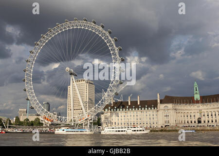The London Eye beside County Hall on the Southbank London England UK - Stock Photo