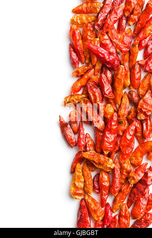 Dried mini chili peppers isolated on white background. - Stock Photo