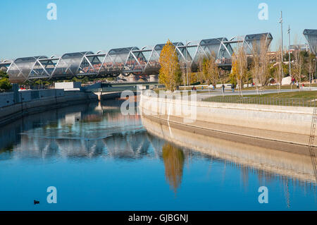 Bridge by Perrault and river Manzanares. Madrid Rio park, Madrid, Spain. - Stock Photo