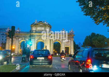 Urban traffic in Alcala gate, night view. Madrid, Spain. - Stock Photo