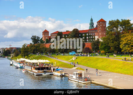 Krakow, Poland - September 27, 2015: People are walking along the Vistula river bank in the historic city center - Stock Photo