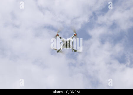 Russia, Poltavskaya village - May 1, 2016: Flying white quadrocopters DJI Phantom 4 over a field of wheat. Flying - Stock Photo