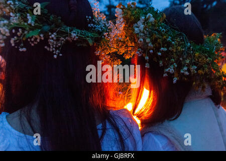 Midsummer Night, girls in wreaths on his head, by the fire, Podlasie, Poland, - Stock Photo