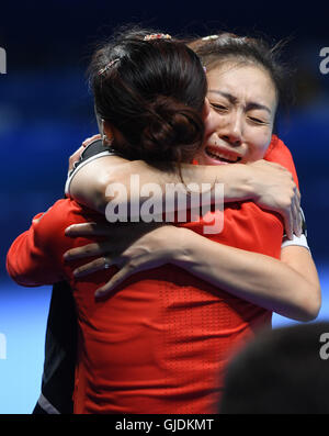 Rio de Janeiro, Brazil. 14th Aug, 2016. Xiaona Shan (L) of Germany celebrates with teammate Ying Han after winning - Stock Photo