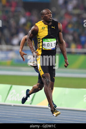 RIO DE JANEIRO, BRAZIL - AUGUST 14: Usain Bolt of Jamaica in the final of the mens 100m during the evening session - Stock Photo