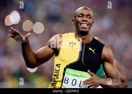 Rio De Janeiro, Brazil. 14th Aug, 2016. Sprinter Usain Bolt of Jamaica celebrates his victory in athletics 100 m - Stock Photo