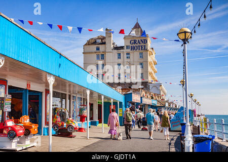 Llandudno, Conwy Wales, UK. 15th Aug, 2016. Summer finally arrives on the North Wales coast, and everyone gets out to enjoy the sunshine. Here people are out walking on the pier. Credit:  travellinglight/Alamy Live News Stock Photo